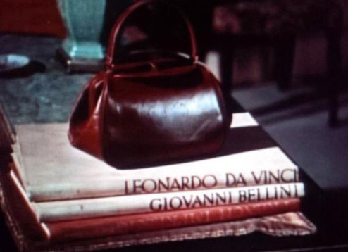 handbag with key hiding casually in plain sight in 'Dial M for Murder' by Alfred Hitchcock.